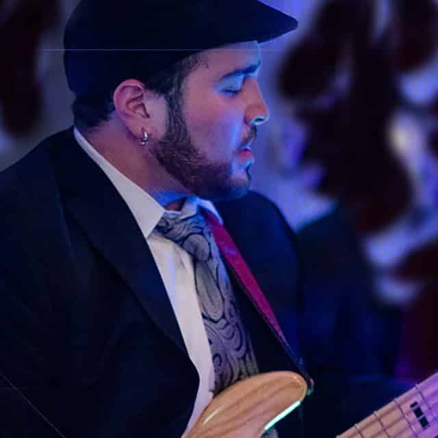 Bassist of Big Party Orchestra performs with wedding band in Maine