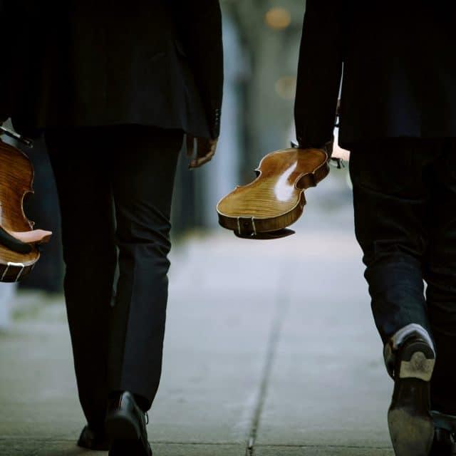 String ensemble musicinas walk to performance