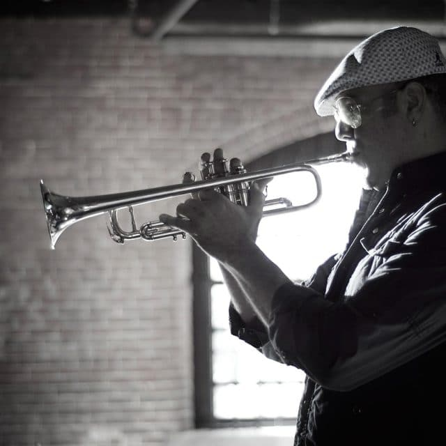 Trumpeter performs at Boston wedding band showcase