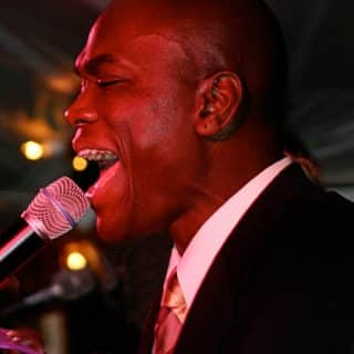 Vocalist with Boston's best wedding band entertains the crowd