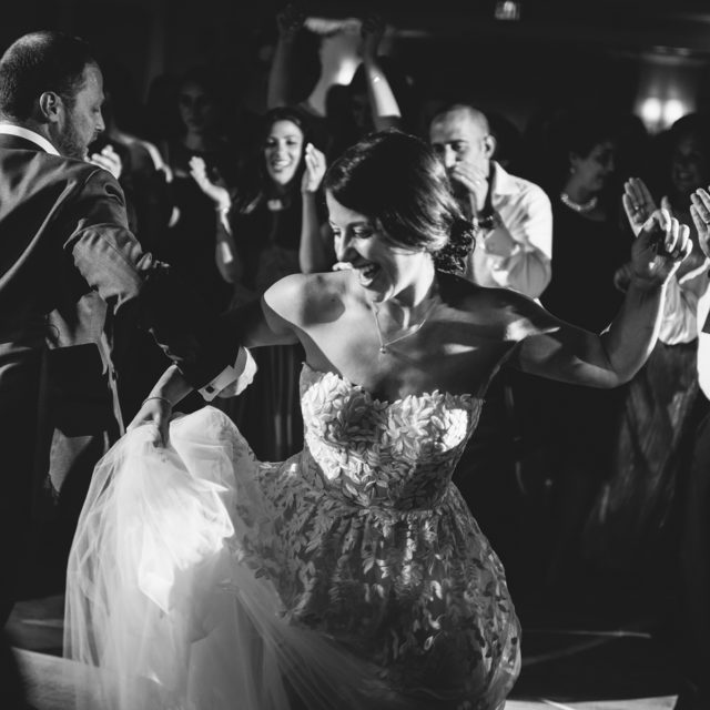 Happy bride dances to the music of Night Shift Entertainment