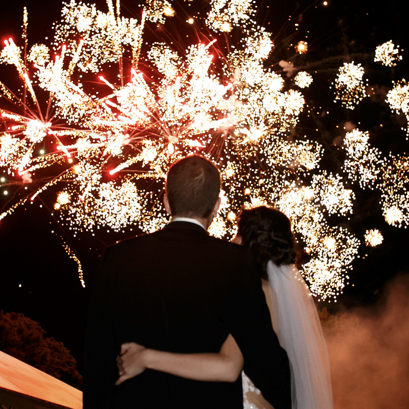Bride and Groom watching their wedding night fireworks