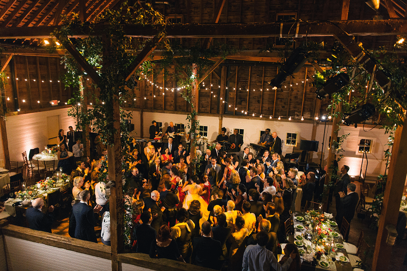 Soho performs at a rustic wedding reception