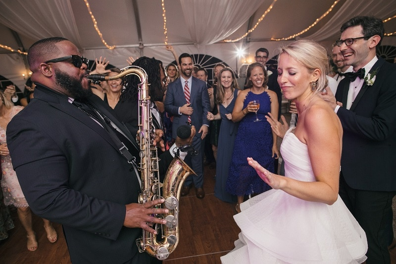 Bride enjoying a saxophone solo with Night Shift Entertainement