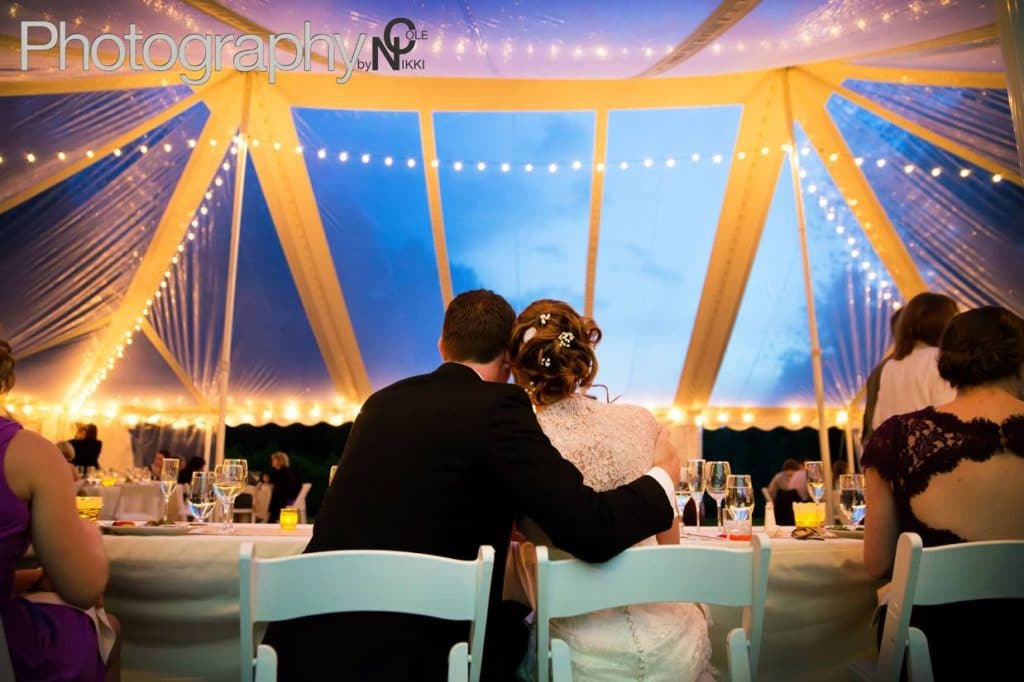 Couple embrace in elegant setting, listening to Night Shift Entertainment