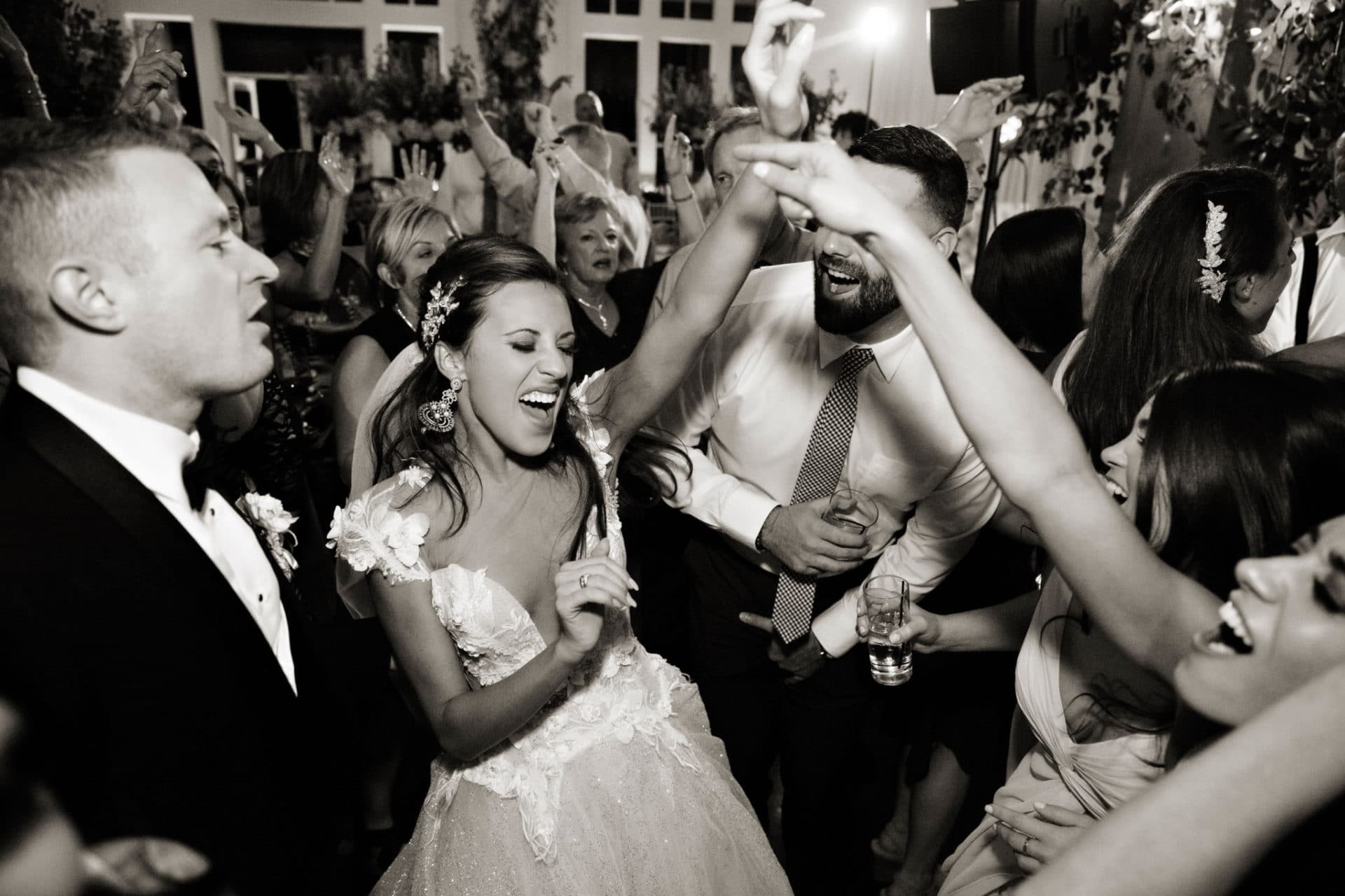Bride, the moment she realizes she's hired the best wedding band in Boston