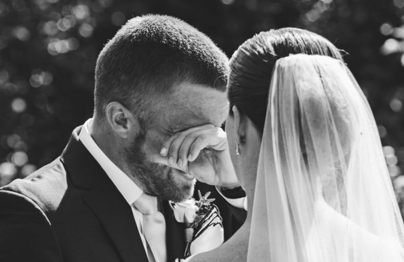 Emotional groom saying vows